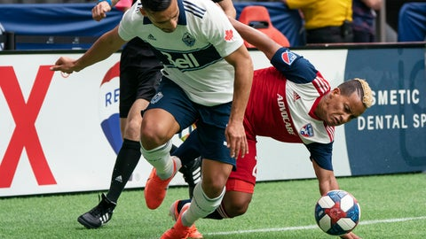 <p>               Vancouver Whitecaps' Ali Adnan, left, battles with FC Dallas' Michael Barrios for control of the ball during the first half of an MLS soccer match Saturday, May 25, 2019, in Vancouver, British Columbia. (Richard Lam/The Canadian Press via AP)             </p>