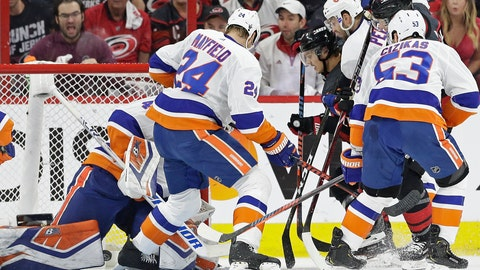 <p>               Carolina Hurricanes' Sebastian Aho scores against New York Islanders goalie Robin Lehner while Islanders' Scott Mayfield (24) and Casey Cizikas (53) defend with Adam Pelech during the first period of Game 4 of an NHL hockey second-round playoff series in Raleigh, N.C., Friday, May 3, 2019. (AP Photo/Gerry Broome)             </p>