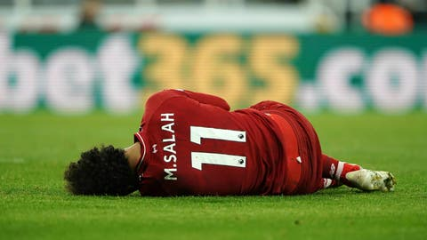 <p>               Liverpool's Mohamed Salah lies injured during a Premier League match against Newcastle United at St James' Park, Newcastle, England, Saturday May 4, 2019. (Owen Humphreys/PA via AP)             </p>
