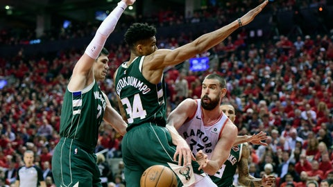 <p>               Toronto Raptors center Marc Gasol (33) moves the ball pass Milwaukee Bucks forward Giannis Antetokounmpo (34) during the second half of Game 4 of the NBA basketball playoffs Eastern Conference finals, Tuesday, May 21, 2019 in Toronto. (Frank Gunn/The Canadian Press via AP)             </p>