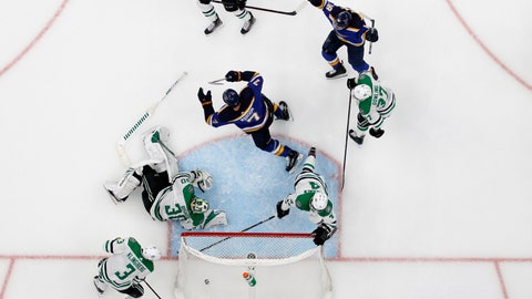<p>               St. Louis Blues' Pat Maroon (7) and Robert Thomas (18) celebrate a score by Maroon, as Dallas Stars' John Klingberg (3), Ben Bishop (30), Miro Heiskanen (4) and Justin Dowling (37) react during the second overtime in Game 7 of an NHL second-round hockey playoff series Tuesday, May 7, 2019, in St. Louis. The Blues won 2-1. (AP Photo/Jeff Roberson)             </p>