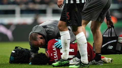 <p>               Liverpool's Mohamed Salah receives treatment after an injury during a Premier League match against Newcastle United at St James' Park, Newcastle, England, Saturday May 4, 2019. (Owen Humphreys/PA via AP)             </p>