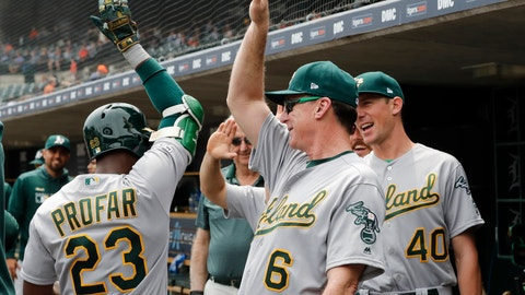 <p>               Oakland Athletics' Jurickson Profar is greeted by manager Bob Melvin (6) and starting pitcher Chris Bassitt (40) after hitting a grand slam in the third inning of a baseball game against the Detroit Tigers, Thursday, May 16, 2019, in Detroit. (AP Photo/Carlos Osorio)             </p>