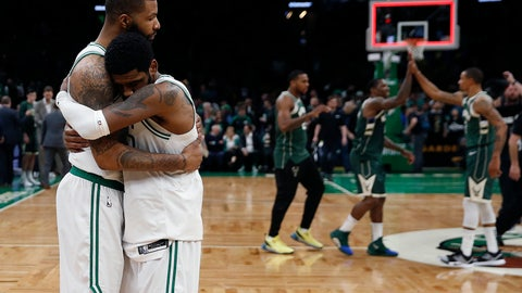 <p>               Boston Celtics' Marcus Morris, left, hugs Kyrie Irving as the Milwaukee Bucks celebrate their 123-116 win in Game 3 of a second round NBA basketball playoff series in Boston, Friday, May 3, 2019. (AP Photo/Michael Dwyer)             </p>