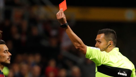 <p>               Referee Marco Di Bello, right, shows a red card to Bologna's Nicola Sansone, left, during the Italian Serie A soccer match between AC Milan and Bologna at the San Siro stadium, in Milan, Italy, Monday, May 6, 2019. Milan won 2-1. (AP Photo/Antonio Calanni)             </p>
