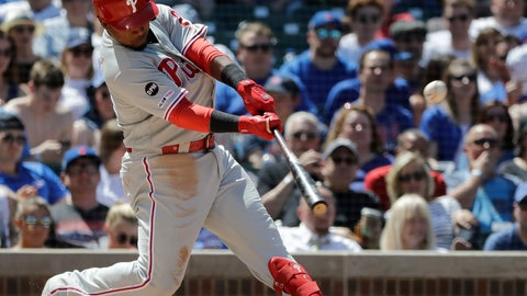 <p>               Philadelphia Phillies' Jean Segura hits a two-run home run against the Chicago Cubs during the fourth inning of a baseball game Thursday, May 23, 2019, in Chicago. (AP Photo/Nam Y. Huh)             </p>
