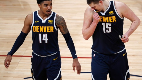 <p>               Denver Nuggets guard Gary Harris (14) and center Nikola Jokic (15) react as time runs out in the second half of Game 7 of an NBA basketball second-round playoff series against the Portland Trail Blazers Sunday, May 12, 2019, in Denver. (AP Photo/David Zalubowski)             </p>
