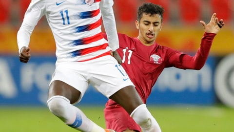 <p>               United States' Tim Weah, front, duels for the ball with Qatar's Abdulla Nasser during the Group D U20 World Cup soccer match between USA and Qatar, in Tychy, Poland, Thursday, May 30, 2019. (AP Photo/Sergei Grits)             </p>