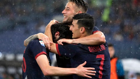 <p>               Bologna's Andrea Poli, left, celebrates with Bologna's Riccardo Orsolini after scoring his side's first goal during an Italian Serie A soccer match between Lazio and Bologna, at the Olympic stadium in Rome, Monday, May 20, 2019. (AP Photo/Andrew Medichini)             </p>