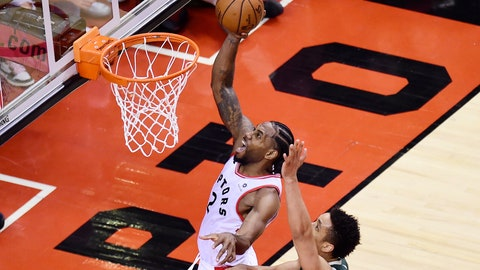 <p>               Toronto Raptors forward Kawhi Leonard (2) scores past Milwaukee Bucks guard Malcolm Brogdon (13) during the second overtime period of Game 3 of the NBA basketball playoffs Eastern Conference finals in Toronto on Sunday, May 19, 2019. (Frank Gunn/The Canadian Press via AP)             </p>