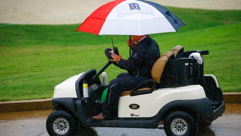 <p>               An official drives the course as play is suspended due to weather during the final round of the Regions Tradition Champions Tour golf tournament, Sunday, May 12, 2019, in Birmingham, Ala. (AP Photo/Butch Dill)             </p>