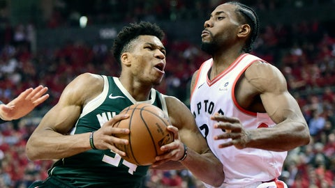 <p>               Milwaukee Bucks forward Giannis Antetokounmpo (34) drives to the basket as Toronto Raptors forward Kawhi Leonard (2) defends during the first half of Game 4 of the NBA basketball playoffs Eastern Conference finals, Tuesday, May 21, 2019 in Toronto. (Frank Gunn/The Canadian Press via AP)             </p>