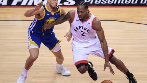 <p>               Toronto Raptors forward Kawhi Leonard (2) drives around Golden State Warriors guard Klay Thompson (11) during the first half of Game 1 of basketball's NBA Finals, Thursday, May 30, 2019, in Toronto. (Nathan Denette/The Canadian Press via AP)             </p>