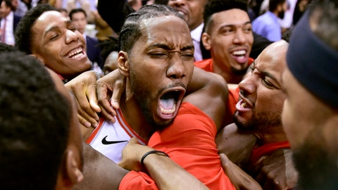 <p>               Toronto Raptors forward Kawhi Leonard, center, celebrates his game-winning basket as time expired at the end of an NBA Eastern Conference semifinal basketball game against the Philadelphia 76ers, in Toronto on Sunday, May 12, 2019. Toronto won 92-90. (Frank Gunn/The Canadian Press via AP)             </p>