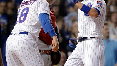 <p>               Chicago Cubs' Ben Zobrist celebrates with Kris Bryant after they scored on a two-run double by Anthony Rizzo during the sixth inning of a baseball game against the St. Louis Cardinals, Sunday, May 5, 2019, in Chicago. (AP Photo/Nam Y. Huh)             </p>