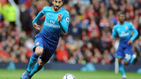 """<p>               FILE - In this Sunday, April 29, 2018 file photo, Arsenal's Henrikh Mkhitaryan runs with the ball during their English Premier League soccer match against Manchester United at the Old Trafford stadium in Manchester, England. Arsenal's Granit Xhaka and Sokratis Papastathopoulos say they want to win the Europa League title for their teammate Henrikh Mkhitaryan, who is missing the final on Wednesday, May 29, 2019 for political reasons. Xhaka says """"of course we're disappointed he's not here,"""" adding that """"we want to give him a trophy too."""" (AP Photo/Rui Vieira, file)             </p>"""