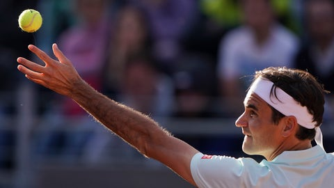 <p>               Roger Federer of Switzerland serves the ball to Borna Cedric of Croatia at the Italian Open tennis tournament, in Rome, Thursday, May 16, 2019. (AP Photo/Andrew Medichini)             </p>