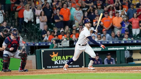 <p>               Houston Astros' Carlos Correa, right, hits a game-winning RBI single as Boston Red Sox catcher Christian Vazquez watches during the ninth inning of a baseball game Saturday, May 25, 2019, in Houston. The Astros won 4-3. (AP Photo/David J. Phillip)             </p>