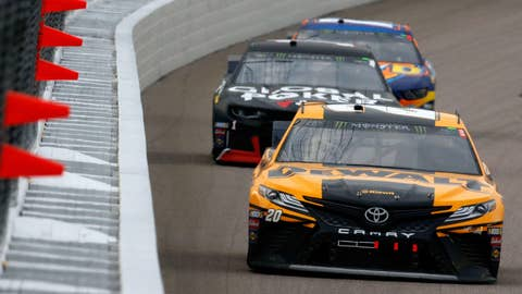 KANSAS CITY, KS - MAY 11:  Erik Jones, driver of the #20 DeWalt Toyota, leads a pack of cars during the Monster Energy NASCAR Cup Series Digital Ally 400 at Kansas Speedway on May 11, 2019 in Kansas City, Kansas.  (Photo by Jonathan Ferrey/Getty Images)