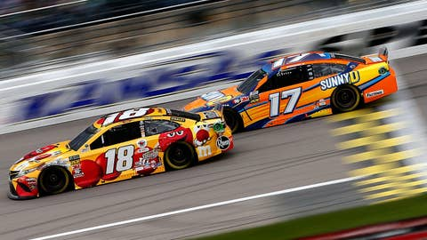 KANSAS CITY, KS - MAY 11:  Kyle Busch, driver of the #18 M&M's Red Nose Day Toyota, races Ricky Stenhouse Jr., driver of the #17 SunnyD Ford, during the Monster Energy NASCAR Cup Series Digital Ally 400 at Kansas Speedway on May 11, 2019 in Kansas City, Kansas.  (Photo by Brian Lawdermilk/Getty Images)