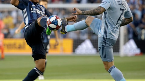 <p>               Sporting Kansas City forward Johnny Russell (7) and LA Galaxy midfielder Jonathan dos Santos compete for the ball during the first half of an MLS soccer match Wednesday, May 29, 2019, in Kansas City, Kan. (AP Photo/Charlie Riedel)             </p>