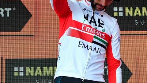 <p>               Colombia's Fernando Gaviria waves from the podium after completing the third stage of the Giro d'Italia, tour of Italy cycling race from Vinci to Orbetello, Monday, May 13, 2019. Fernando Gaviria has been awarded victory of the third stage of the Giro d'Italia after Elia Viviani was relegated for an irregular sprint. (Alessandro Di Meo/ANSA via AP)             </p>