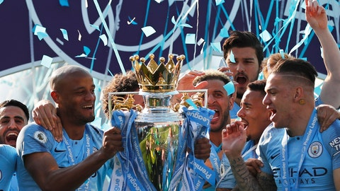 <p>               Manchester City's Vincent Kompany lifts the English Premier League trophy after the English Premier League soccer match between Brighton and Manchester City at the AMEX Stadium in Brighton, England, Sunday, May 12, 2019. Manchester City defeated Brighton 4-1 to win the championship. (AP Photo/Frank Augstein)             </p>