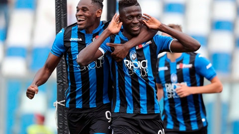 <p>               Atalanta's Musa Barrow, right, celebrates with his teammate Duvan Zapata after scoring during a Serie A soccer between Atalanta and Genoa at the Mapei Stadium in Reggio Emilia, Italy, Saturday, May 11, 2019. (Paolo Magni/ANSA via AP)             </p>