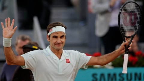 <p>               Roger Federer, from Switzerland, celebrates after winning right, embraces Richard Gasquet, from France, during the Madrid Open tennis tournament in Madrid, Tuesday, May 7, 2019. (AP Photo/Bernat Armangue)             </p>