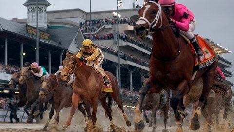 <p>               Luis Saez rides Maximum Security, right, across the finish line first against Flavien Prat on Country House during the 145th running of the Kentucky Derby horse race at Churchill Downs Saturday, May 4, 2019, in Louisville, Ky. Country House was declared the winner after Maximum Security was disqualified following a review by race stewards. (AP Photo/Matt Slocum)             </p>