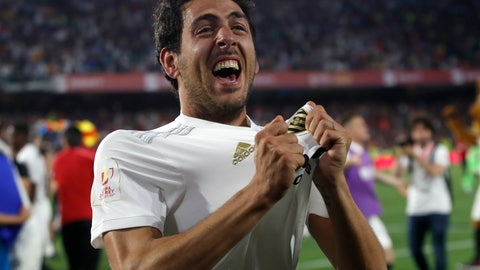 <p>               Valencia midfielder Daniel Parejo celebrates after his team's win in the Copa del Rey soccer match final between Valencia CF and FC Barcelona at the Benito Villamarin stadium in Seville, Spain, Saturday. 25, 2019. (AP Photo/Miguel Morenatti)             </p>