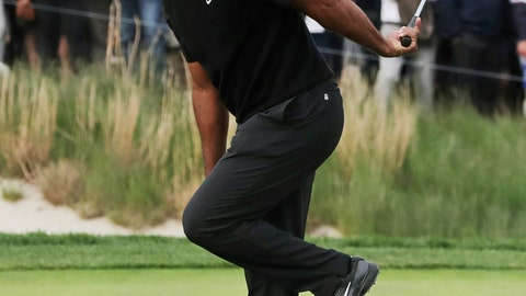 <p>               Tiger Woods reacts after missing a putt for birdie on the 17th green during the second round of the PGA Championship golf tournament, Friday, May 17, 2019, at Bethpage Black in Farmingdale, N.Y. (AP Photo/Charles Krupa)             </p>