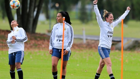 <p>               Argentine women's soccer team player Aldana Cometti, right, celebrates as Yael Oviedo stands at center during training ahead of the FIFA Women's World Cup France 2019 tournament, at the Argentina Football Association in Ezeiza on the outskirts of Buenos Aires, Argentina, Monday, May 20, 2019. Argentina players that took the team to its first women's World Cup in 12 years organized a strike in the end of 2017 due to the lack of support they endured, kicking off a movement against sexism that forced the country's soccer body to change and turn them into professionals. (AP Photo)             </p>