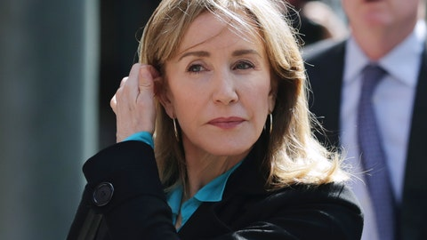 <p>               FILE - In this April 3, 2019 file photo, actress Felicity Huffman arrives at federal court in Boston to face charges in a nationwide college admissions bribery scandal. On Monday, May 13, 2019, Huffman is expected to plead guilty to charges that she took part in the cheating scam. (AP Photo/Charles Krupa, File)             </p>