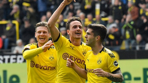 <p>               Dortmund's Christian Pulisic celebrates his opening goal with Thomas Delaney and Lukasz Piszczek, from right, during the German Bundesliga soccer match between Borussia Dortmund and Fortuna Duesseldorf in Dortmund, Germany, Saturday, May 11, 2019. (AP Photo/Martin Meissner)             </p>