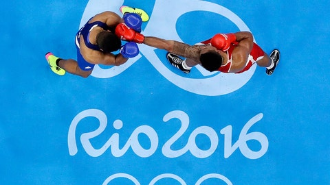 <p>               FILE - In this Sunday, Aug. 21, 2016 file photo, France's Tony Victor James Yoka, right, fights Britain's Joe Joyce during a men's super heavyweight over 91-kg final boxing match at the 2016 Summer Olympics in Rio de Janeiro, Brazil. The embattled amateur boxing federation faces an Olympic inquiry on Monday May 20, 2019 fearing it could be punished for forcing out a longtime IOC member as its president. (AP Photo/Frank Franklin II, File)             </p>