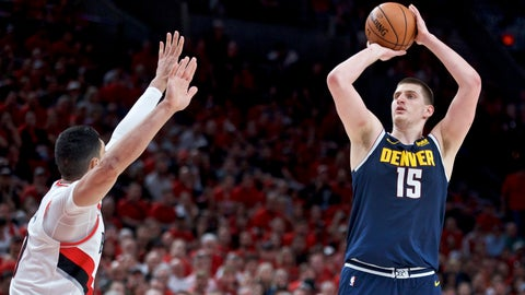 <p>               Denver Nuggets center Nikola Jokic, right,  looks to shoot over Portland Trail Blazers center Enes Kanter during the first half of Game 4 of an NBA basketball second-round playoff series Sunday, May 5, 2019, in Portland, Ore. (AP Photo/Craig Mitchelldyer)             </p>