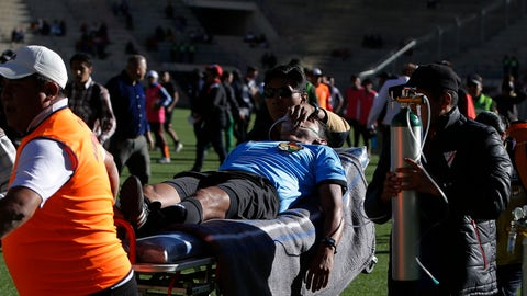 """<p>               Referee Victor Hugo Hurtado is transported off the field to the hospital after fainting during a soccer game between the Always Ready team and Oriente Petrolero team, part of the """"Apertura"""" local soccer tournament in El Alto, Bolivia, Sunday, May 19, 2019. Hurtado, 31, died later at the hospital of cardiac arrest, according to Fernando Costa, president of the Always Ready soccer club. (AP Photo/Juan Carlos Usnayo)             </p>"""