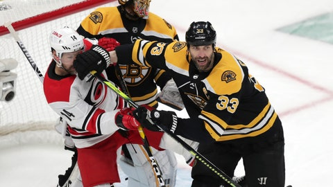 <p>               Boston Bruins' Zdeno Chara (33), of Slovakia, pushes Carolina Hurricanes' Justin Williams (14) away from Bruins goalie Tuukka Rask during the first period in Game 2 of the NHL hockey Stanley Cup Eastern Conference final series, Sunday, May 12, 2019, in Boston. (AP Photo/Charles Krupa)             </p>