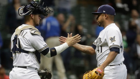 <p>               Milwaukee Brewers' Yasmani Grandal and Junior Guerra celebrate after a baseball game against the Washington Nationals Monday, May 6, 2019, in Milwaukee. The Brewers won 5-3. (AP Photo/Morry Gash)             </p>