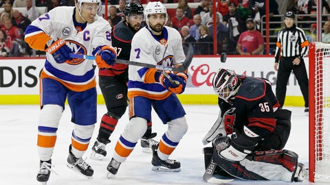 <p>               Carolina Hurricanes goalie Curtis McElhinney (35) defends the goal against New York Islanders' Anders Lee (27) and Jordan Eberle (7) while Hurricanes' Justin Faulk watches at rear during the first period of Game 3 of an NHL hockey second-round playoff series in Raleigh, N.C., Wednesday, May 1, 2019. (AP Photo/Gerry Broome)             </p>