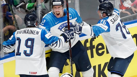 <p>               Finland's Marko Anttila (12) celebrates with Veli-Matti Savinainen (19) and Jere Sallinen (76) after Anttila scored his second goal of the game against Canada during the Ice Hockey World Championships gold medal match at the Ondrej Nepela Arena in Bratislava, Slovakia, Sunday, May 26, 2019. (AP Photo/Petr David Josek)             </p>