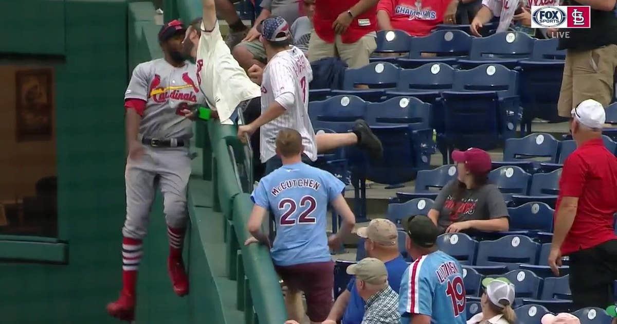 WATCH: Fowler climbs wall for final out, ends Cards' win with an exclamation point