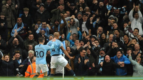 <p>               Manchester City's Vincent Kompany, second left, celebrates with Manchester City's Bernardo Silva after scoring his side's opening goal during the English Premier League soccer match between Manchester City and Leicester City at the Etihad stadium in Manchester, England, Monday, May 6, 2019. (AP Photo/Rui Vieira)             </p>