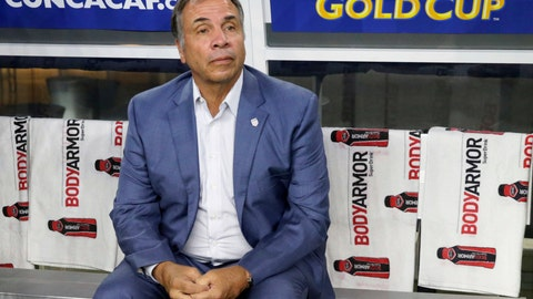 <p>               FILE - In this July 22, 2017, file photo, United States head coach Bruce Arena sits on the bench prior to a CONCACAF Gold Cup semifinal soccer match against Costa Rica, in Arlington, Texas. The New England Revolution have hired five-time MLS Cup winner and former U.S. national coach Bruce Arena as its coach and sports director. (AP Photo/LM Otero, File)             </p>