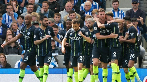 <p>               Manchester City's Aymeric Laporte is hugged by teammate Kyle Walker, foreground right, after scoring his side's second goal during the English Premier League soccer match between Brighton and Manchester City at the AMEX Stadium in Brighton, England, Sunday, May 12, 2019. (AP Photo/Frank Augstein)             </p>