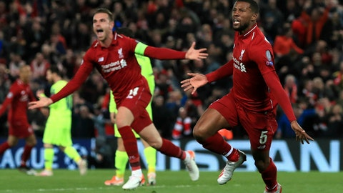 <p>               Liverpool's Georginio Wijnaldum, right, celebrates scoring his side's third goal of the game during the Champions League Semi Final, second leg soccer match between Liverpool and Barcelona at Anfield, Liverpool, England, Tuesday, May 7, 2019. (Peter Byrne/PA via AP)             </p>