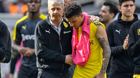 <p>               Dortmund coach Lucien Favre comforts Dortmund's Jadon Sancho after the German Bundesliga soccer match between Borussia Moenchengladbach and Borussia Dortmund in Moenchengladbach, Germany, Saturday, May 18, 2019. Dortmund finished the season on the second place behind Bayern Munich. (AP Photo/Martin Meissner)             </p>