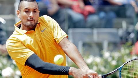 <p>               Nick Kyrgios of Australia returns the ball to Daniil Medvedev of Russia at the Italian Open tennis tournament, in Rome, Tuesday, May, 14, 2019. Kyrgios won 6-3, 3-6, 6-3. (AP Photo/Andrew Medichini)             </p>