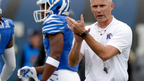 <p>               FILE - In this Oct. 13, 2018, file photo, Memphis head coach Mike Norvell watches players warm up before an NCAA college football game against Central Florida, in Memphis, Tenn. The portal is the NCAA's cryptic name for the database it maintains to track which athletes, in all sports, have notified their schools they wish to transfer. (AP Photo/Mark Zaleski, File)             </p>